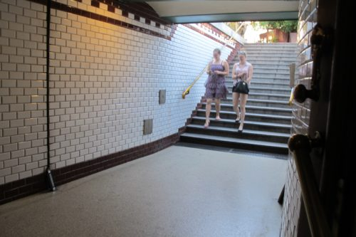 The stairway and entrance to Budapest's Oktogon subway station features white subway tiles and black tile borders. Photo by Barbara Newhall
