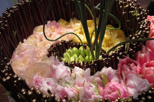 "For the De Young Museum's Bouquets to Art show, a flat floral design by Poppy's Petalworks, San Francisco. Painting ""Tulip Culture,"" by George Hitchcock. Photo by Barbara Newhall."