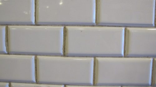 Subway tiles in Budapest's Oktogon metro station with grimy grout. Photo by Barbara Newhall
