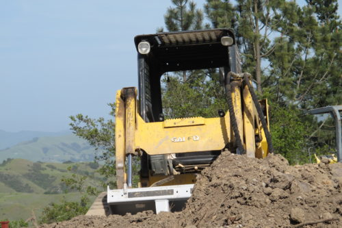 An earth mover at work on a construction site, analogous to rebuilding a mobile friendly website. Photo by Barbara Newhall