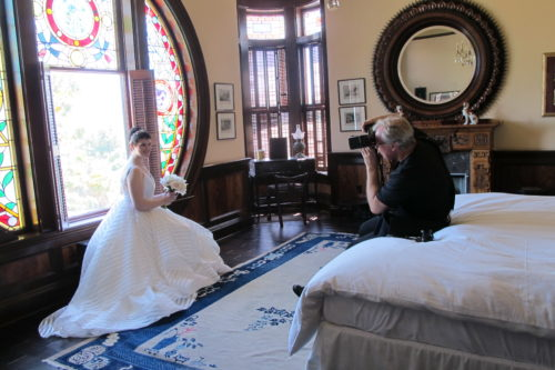 The bride was beautiful. Photographer Asgeir at working taking photos of the bride before the wedding. Photo by Barbara Newhall
