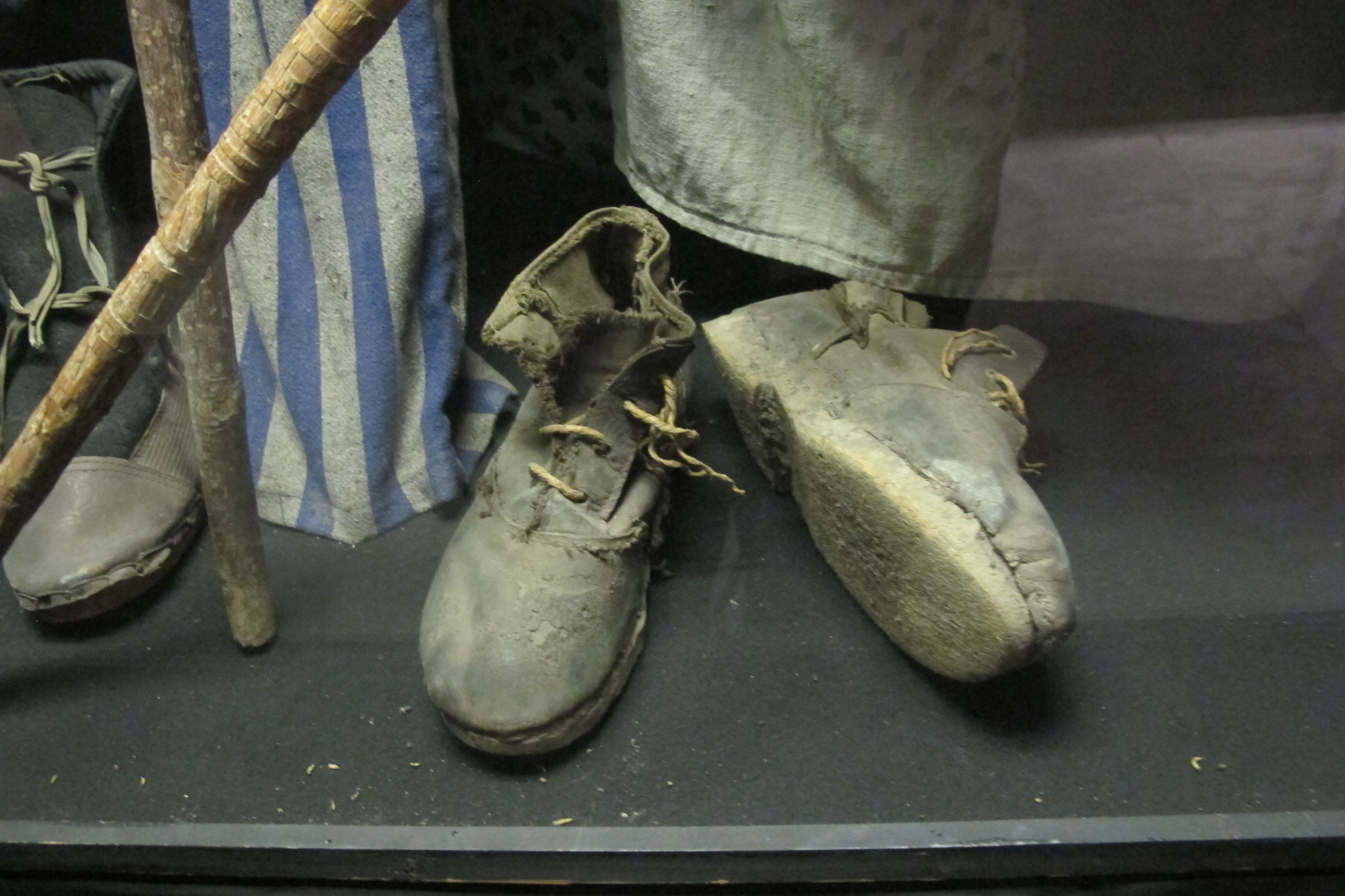 Ernie Hollander: Shoes and clothing worn by prisoners at Nazi concentration camps during World War II. Photo by Barbara Newhall