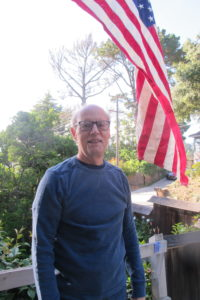Jon Newhall and the American flag. The Stars and Stripes fly over a house in liberal San Francisco Bay. Photo by Barbara Newhall