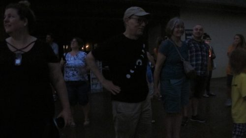 A totality disappointment: Eclipse chasers in deep darkness during total sun eclipse in St. Joseph, MO, August, 2017. Photo by Barbara Newhall