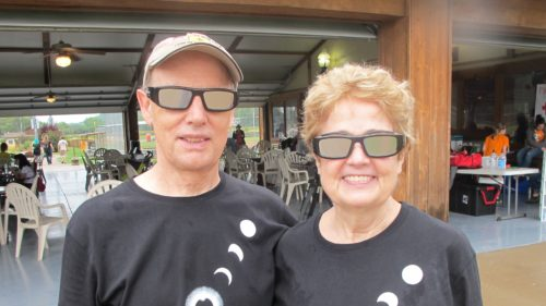 A totality disappointment: Jon and Barbara Newhall sport eclipse viewing glasses and snazzy eclipse T-shirts for the total solar eclipse in St. Joseph, MO, August, 2017. Barbara Newhall photo