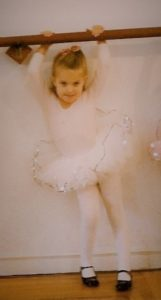 Preschooler at the barre, she loved feminine pink, but did not grow up to find spike heels feminine. Photo by Barbara Newhall
