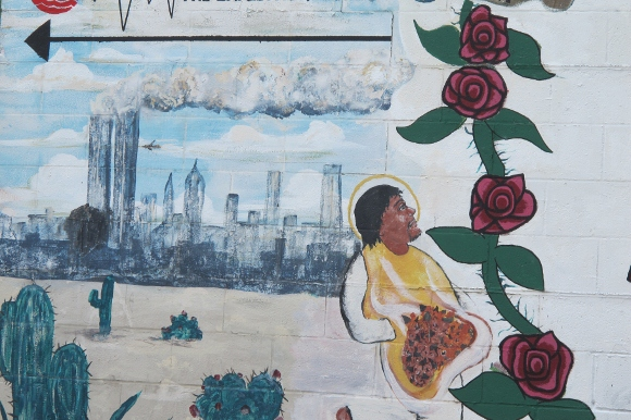 Detail of a mural on outside wall of the Kleen Wash laundromat in austin, tx, showing plane crashing into twin towers on 9/11. photo by bf newhall