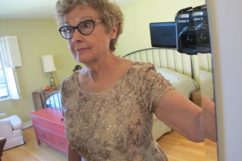 75551f2cccd A mother of the bride tries on dresses to cover her figure flaws -- flabby