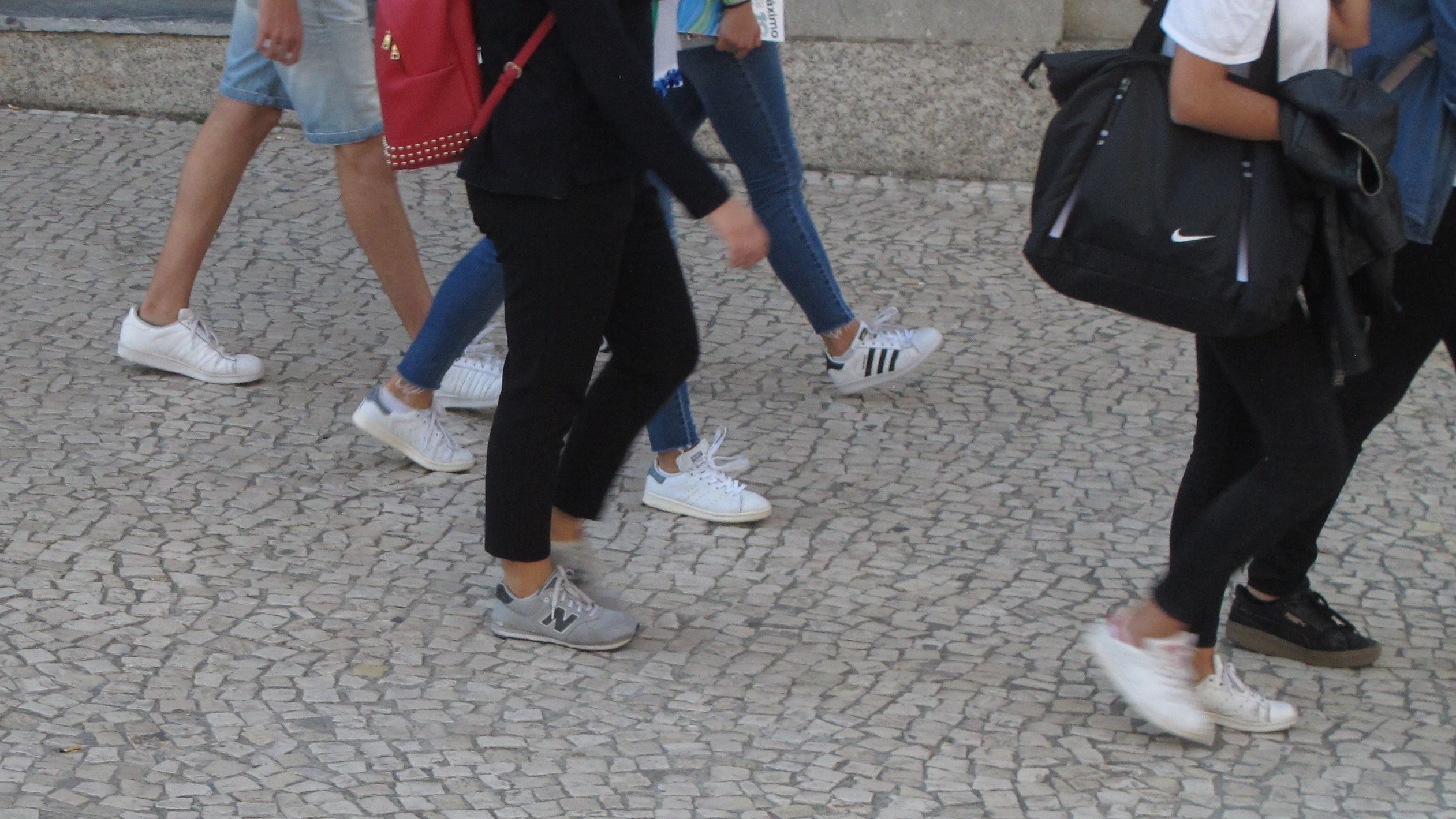 49e6f06d678 White sneakers witih jeans or leggings were de rigueur on the streets of  Lisbon